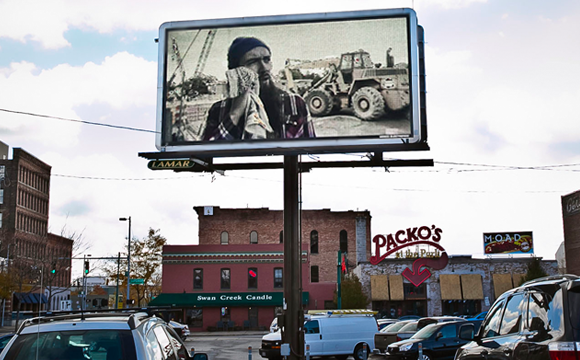 Image of digital billboard featuring work of UT student Mark Yappueying