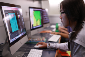 Photo of student designing something at a computer